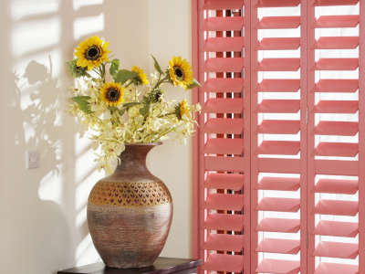 A bright coloured plantation window shutter, demonstrating you don't just have to select a standard white finish.