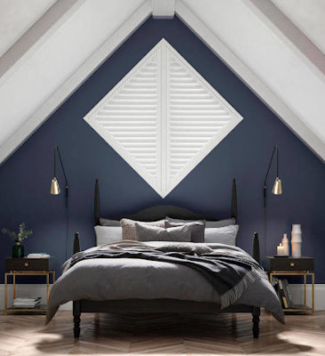 A diamond shaped bespoke window shutters. Shutters can be made in a variety of special shapes.