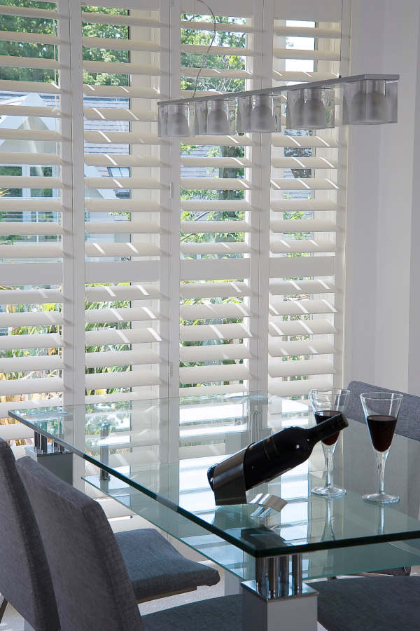 Shutters are easy to maintain and have strong thermal properties. They are perfect for dining rooms.