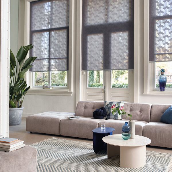 Luxaflex Roller Blinds in a High Ceiling Lounge by Mirmac
