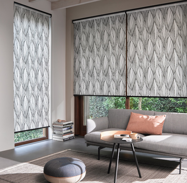 Roller blinds in a lounge setting.  Available in a wide range of patterned fabrics.