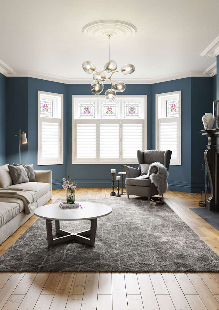 White shutters and wood floor in living room