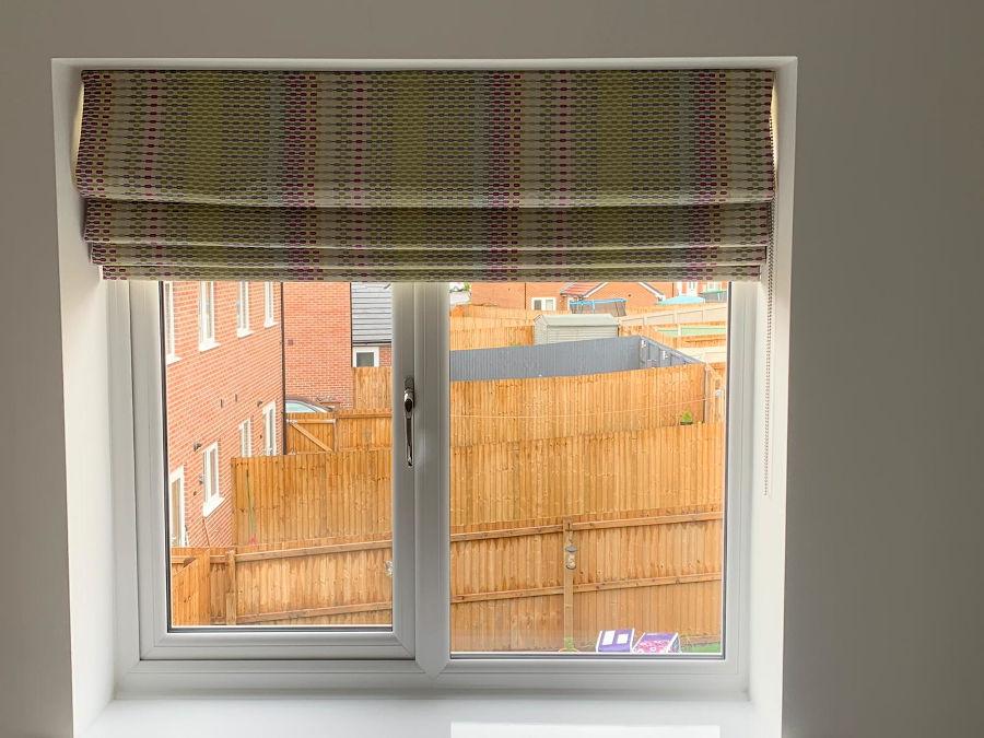 A roman blind in a bedroom window